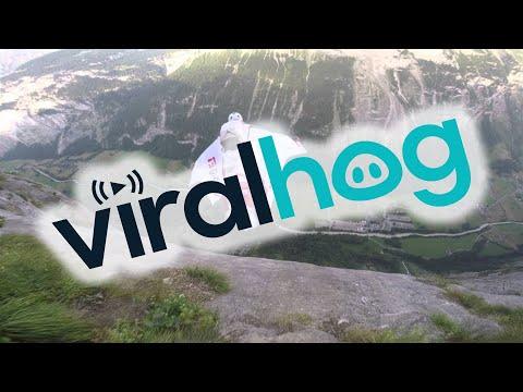 Wingsuit Base Jumping in Switzerland Through Waterfall