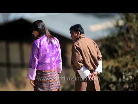 Bhutanese people in traditional national dress - Gho and Kira