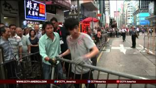 See the news report video by Hong Kong protesters clash with anti-Occupy crowds
