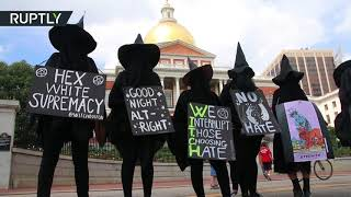 Torched Confederate flag & witch costumes: Activists protest against 'Free speech' rally in Boston - RUSSIATODAY