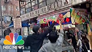 Money Rains Down On Hong Kong Street During Puzzling Stunt | NBC News - NBCNEWS