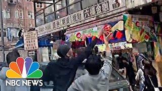 Money Rains Down On Hong Kong Street During Puzzling Stunt | NBC News - NBCNEWS