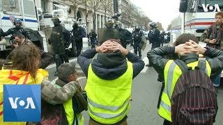 Protesters Kneel Before Police in Shopping District at Paris Protest - VOAVIDEO