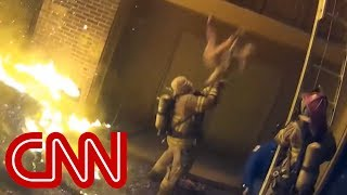 Firefighter catches child tossed from burning building - CNN