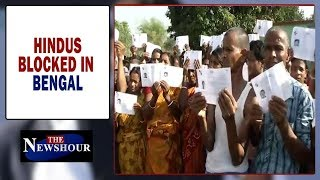 Hindus 'BLOCKED' from voting, TIMES NOW confronts polling officer | The Newshour Debate (18th Apr) - TIMESNOWONLINE