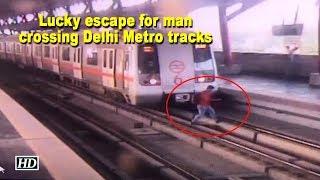 Lucky escape for man crossing Delhi Metro tracks - IANSLIVE