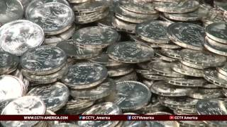 See the news report video by Piggy banks to blame for Colombia's coin shortage