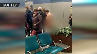 NAKED man tries to board plane in Moscow airport - RUSSIATODAY