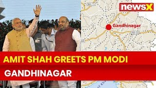 Lok Sabha Election 2019 Phase 3 Voting Day:Amit Shah greets PM Narendra Modi in Gandhinagar, Gujarat - NEWSXLIVE