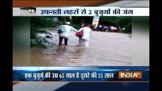 Two elderly men swept away in Maharashtra flood, rescued - INDIATV