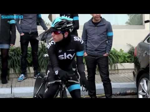 Team Sky pushing their Time Trial bikes and eachother in practice