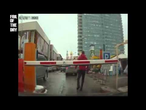 Parking Gate Barrier Hits Guy on his Head FAIL