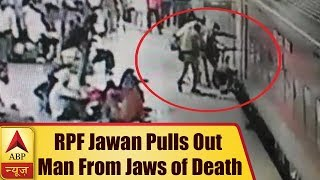 Jhansi: RPF Jawan pulls out man from jaws of death - ABPNEWSTV