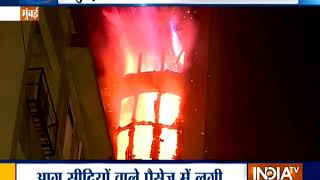 Fire brakes out in an apartment at Malabar Hills area in Mumbai, fire fighting operation underway - INDIATV