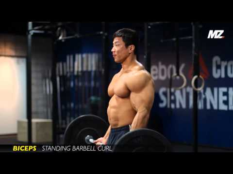 Korean Bodybuilder doing barbell curls