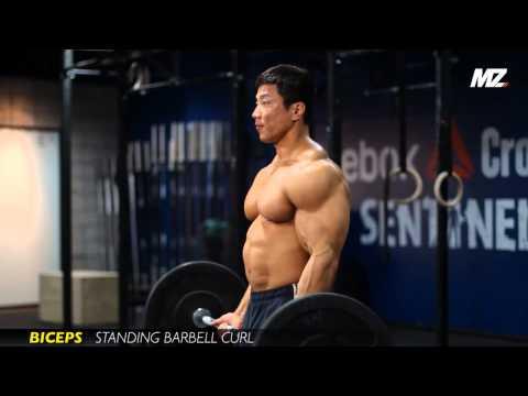 Korean Bodybuilder doing barbell curls