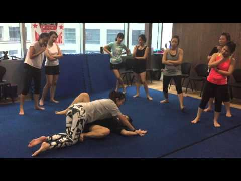 Ladies from Amex learning Modern Street Combatives