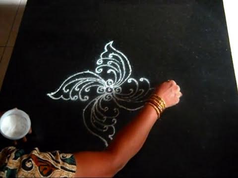 kolam or rangoli design (9-1 dots) - peacocks