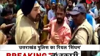Watch: Uttarakhand Sikh police officer saves Muslim youth from violent mob - ZEENEWS