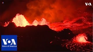 Lava from Hawaii's erupting Kilauea volcano lit up the night on Tuesday (May 22) - VOAVIDEO