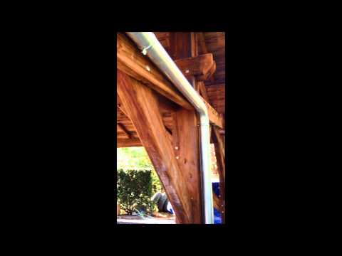 Création et montage d'un abri en bois pour voiture