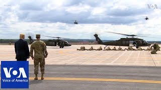 Trump observes military demonstration, signs the National Defense Authorization Act - VOAVIDEO