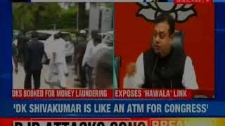 BJP attacks Congress over money laundering case - NEWSXLIVE