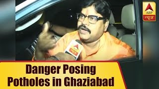 Ghaziabad: Potholes still pose danger for people travelling via Delhi-Lucknow NH - ABPNEWSTV