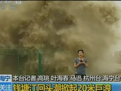 Look behind you Huge wave lands on TV reporter
