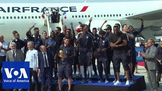 World Cup-winning French team returns home - VOAVIDEO