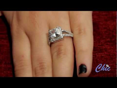Elegant cubic zirconia ring with split shank, surrounded by pave  stones in white gold-itme # 8031