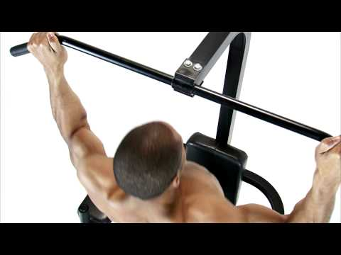Royalty Free Stock Footage of Jib shot of a man doing pull-ups on a white background.