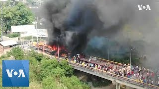Trucks Loaded With Aid Set On Fire at Venezuela-Colombia Border - VOAVIDEO