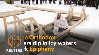 Russians brave freezing water to mark Epiphany - REUTERSVIDEO