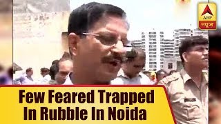 Noida Extension Building Collapse: 3-4 people are suspected to be stuck under the debris, - ABPNEWSTV