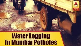 Heavy rain lashes Mumbai once again, traffic crawls due to water logging in potholes - ABPNEWSTV