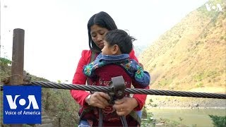 Villagers in southwest China hang on for dear life to cross rivers on ziplines - VOAVIDEO