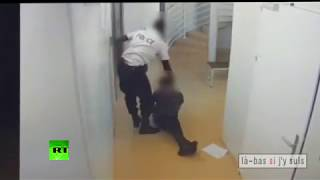 CCTV: French trainee cop beats & drags prisoner, gets detained (DISTURBING) - RUSSIATODAY