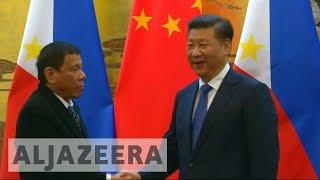 Philippines' Duterte warms China ties with Beijing visit - ALJAZEERAENGLISH