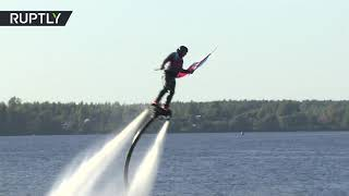 Take off above Volga: Flyboarders perform astonishing manoeuvres - RUSSIATODAY