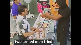 Texas store owner and his son fights off two gun-wielding robbers - VOAVIDEO