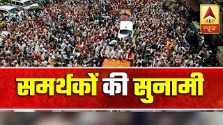 Sea of supporters flood the streets of Varanasi as PM Modi's carcade passes - ABPNEWSTV