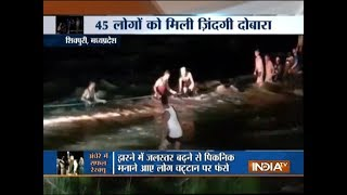 Madhya Pradesh: Over 50 people washed away during picnic at Shivpuri waterfall, 45 rescued - INDIATV