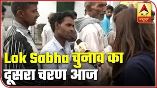 Amroha residents stand in long queues to vote for their candidate - ABPNEWSTV
