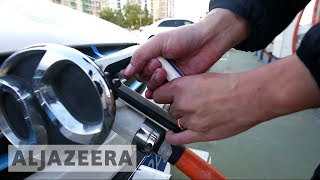 China drives consumers to electric cars - ALJAZEERAENGLISH