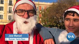 Thousands Dressed as Santa Race in Madrid Raising Money for Cancer Care - VOAVIDEO