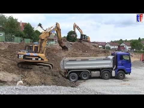 MAN TGS DUMP TRUCK &Cat 318B L / Bauprojekt in Leutenbach, 2013.