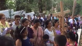 People participate in 'Way of the Cross' procession at Altinho in Panaji - TIMESOFINDIACHANNEL