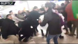 RAW: Turks vs Kurds mass brawl in Hannover Airport - RUSSIATODAY