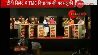 TMC MLA attacks BJP leader with mic in between debate - ZEENEWS